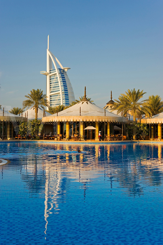 Dubai.  View over enormous swimming pool, restaurants and bars at Al Qasr Hotel of Burj al Arab Hotel..