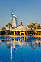 Dubai.  View over enormous swimming pool, restaurants and bars at Al Qasr Hotel of Burj al Arab Hotel..