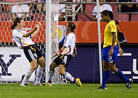 German forward (9) Birgit Prinz  celebrates a goal with teammate forward (8) Sandra Smisek. Germany (GER) defeated Brazil 2-0 in the finals of the Women's World Cup China 2007 at Shanghai Hongkou Football Stadium, Shanghai, China, on September 30, 2007.