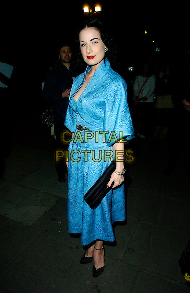 DITA VON TEESE.Arrives for a VIP private view of Kylie - The Exhibition at the Victoria & Albert (V&A) Museum, London,.England, February 6th 2007..full length blue silk dress jacket black clutch bag shoes.CAP/CAN.©Can Nguyen/Capital Pictures