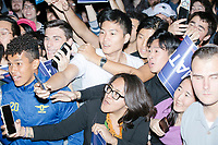 """People clamor to get close to the candidate as entrepreneur and Democratic presidential candidate Andrew Yang greets people and poses for selfies after speaking to a large crowd in Cambridge Common near Harvard Square in Cambridge, Massachusetts, on Mon., September 16, 2019. Yang's unlikely presidential bid is centered on his idea for a """"Freedom dividend,"""" which would give USD$1000 per month to every adult in the United States. After appearing in three Democratic party debates, Yang has risen in polls from longshot candidate to within the top 10.   In the picture, people can be seen holding MATH signs or wearing hats that say MATH. The slogan MATH is now said to mean """"Make America Think Harder"""" and the candidate frequently sites statistics and mathematics in his speeches."""