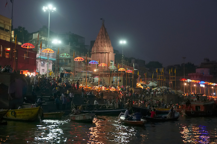 Land and water borne people clog the riverfront of the Ganges for the evening Aarti, a Hindu religious ritual of worship.