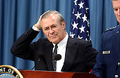United States Secretary of Defense Donald Rumsfeld conducts a press briefing at the Pentagon in Washington, DC on April 9, 2003.<br /> Credit: Ron Sachs / CNP