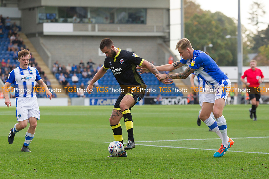 Frankie Kent of Colchester United keeps Ollie Palmer of Crawley Town with his back to goal during Colchester United vs Crawley Town, Sky Bet EFL League 2 Football at the JobServe Community Stadium on 13th October 2018