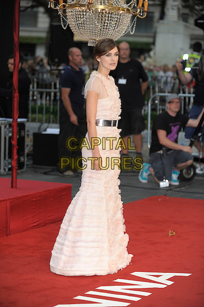 Keira Knightley (wearing Chanel)  .The World Premiere of 'Anna Karenina', The Odeon Leicester Square, London, England..4th September 2012.full length peach pink white sheer fluffy ruffle dress silver belt  SIDE .CAP/PL.©Phil Loftus/Capital Pictures.