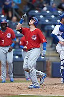 Reese McGuire (3) of the Buffalo Bison points to the sky after crossing home plate following his 2-run home run against the Durham Bulls at Durham Bulls Athletic Park on April 25, 2018 in Allentown, Pennsylvania.  The Bison defeated the Bulls 5-2.  (Brian Westerholt/Four Seam Images)