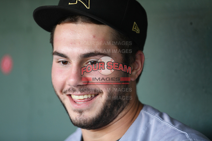 First baseman Logan Wyatt (16) of the Augusta GreenJackets in the dugout before a game against the Greenville Drive on Thursday, August 29, 2019, at Fluor Field at the West End in Greenville, South Carolina. Augusta won, 11-0. (Tom Priddy/Four Seam Images)
