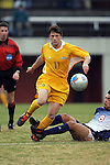 27 November 2005: UNC-G's Scott Jones (11) steps through the tackle of SMU's Bruno Guarda (8). Southern Methodist University defeated the University of North Carolina at Greensboro 3-1 at UNC-G Soccer Stadium in Greensboro, North Carolina in a 2005 NCAA Men's Soccer Tournament game.