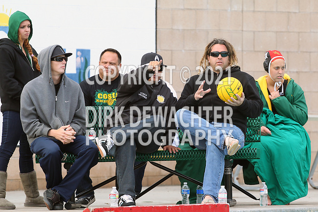 Manhattan Beach, CA 02/16/11 -  Mira Costa's coaching staff looks at the action in the water during the 2011 first round CIF girls waterpolo playoffs between Edison and Mira Costa.