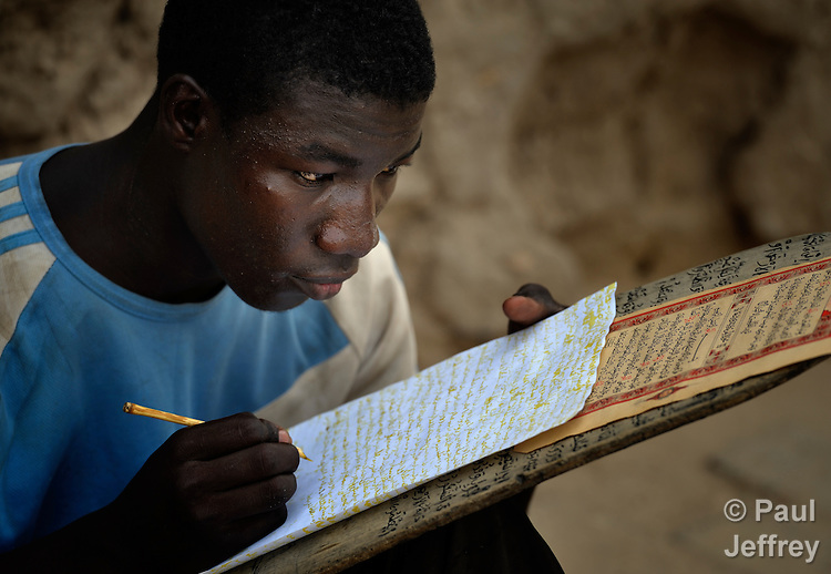 A boy copies Koranic verses in a Muslim school in Timbuktu, the northern Mali city that was seized by Islamist fighters in 2012 and then liberated by French and Malian soldiers in early 2013.