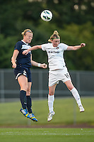 Sky Blue FC defender CoCo Goodson (2) goes up for a header with Washington Spirit forward Conny Pohlers (16). Sky Blue FC defeated the Washington Spirit 1-0 during a National Women's Soccer League (NWSL) match at Yurcak Field in Piscataway, NJ, on August 3, 2013.