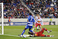 New York Red Bulls goalkeeper Bouna Coundoul (18) stops Jeff Cunningham (9) of FC Dallas. The New York Red Bulls defeated FC Dallas 2-1 during a Major League Soccer (MLS) match at Red Bull Arena in Harrison, NJ, on April 17, 2010.