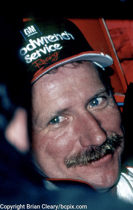NASCAR Legend Dale Earnhardt smiles as he sits in his car at Talladega, 1990's.  (Photo by Brian Cleary/www.bcpix.com)