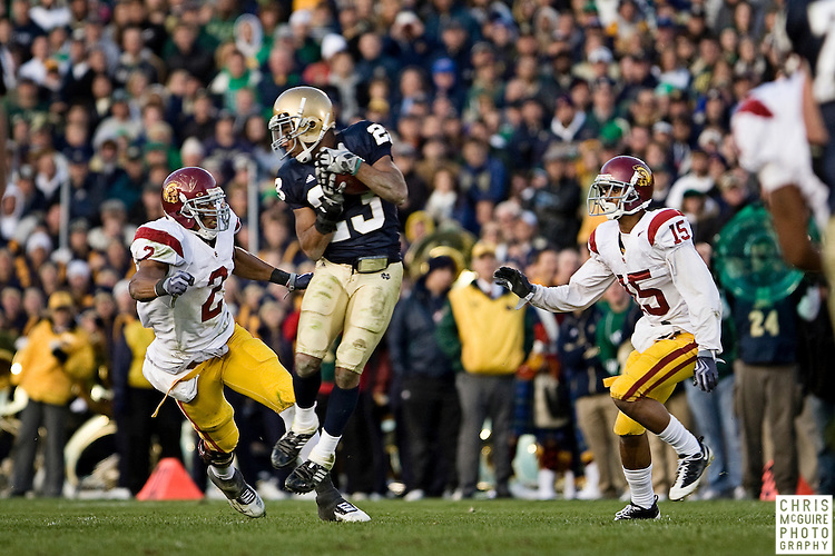 10/17/09 - South Bend, IN:  Notre Dame wide receiver Golden Tate hauls in a reception against USC during their game at Notre Dame Stadium on Saturday.  USC won the game 34-27 to extend its win streak over Notre Dame to 8 games.  Photo by Christopher McGuire.