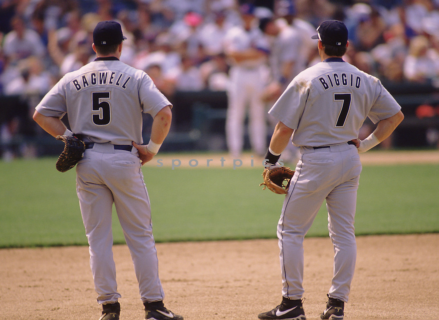 Houston Astrso Jeff Bagell (5) and Craig Biggio (7) talk during a pitching change a game from the 1997 season against the Cubs at Wrigley field.  Both player spent their entire career with the Houston Astros playing together for 15 years.(SportPics)