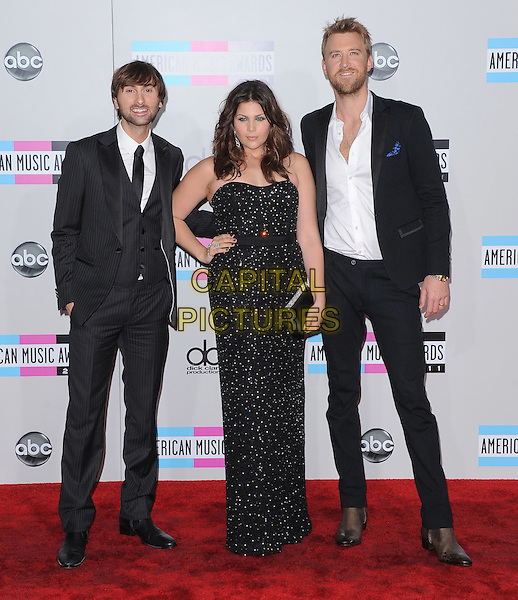Lady Antebellum - Dave Haywood,  Hillary Scott & Charles Kelley.2011 American Music Awards held at The Nokia Theater Live in Los Angeles, California, USA..November 20th, 2011.AMA AMAS AMA's full length black strapless dress white shirt suit hand on hip.CAP/RKE/DVS.©DVS/RockinExposures/Capital Pictures.