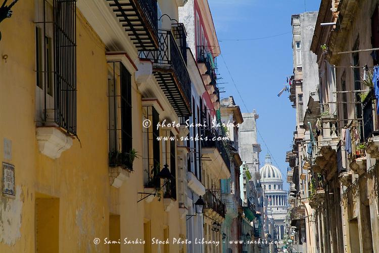 City street near Plaza Vieja with El Capitolio in the background, Havana, Cuba.