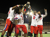 Manatee Hurricanes head coach Joe Kinnan (center) and team captains Clinton Heaven #20, Darius White #52, Leon Allen #7, Jalen Holmes #6, and Garrett Waiters #75 hoist the Championship trophy after the Florida High School Athletic Association 7A Championship Game at Florida's Citrus Bowl on December 16, 2011 in Orlando, Florida.  Manatee defeated First Coast 40-0.  (Photo By Mike Janes Photography)