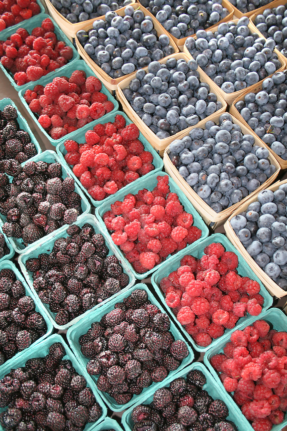 Raspberries blueberries at farmers market in South Haven Michigan