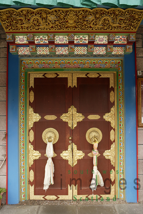 Samye Ling Monastry and Tibetan Centre Eskdalemuir near Langolm Dumfries and Galloway elaborate decoratated door on outside off temple