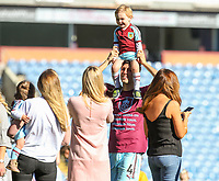 Burnley's Jack Cork enjoys a moment with family members on the pitch after the match<br /> <br /> Photographer Alex Dodd/CameraSport<br /> <br /> The Premier League - Burnley v Bournemouth - Sunday 13th May 2018 - Turf Moor - Burnley<br /> <br /> World Copyright &copy; 2018 CameraSport. All rights reserved. 43 Linden Ave. Countesthorpe. Leicester. England. LE8 5PG - Tel: +44 (0) 116 277 4147 - admin@camerasport.com - www.camerasport.com