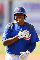 Chattanooga Lookouts third baseman Daniel Mayora (17) grabs his chest jokingly after almost being hit by a line drive during batting practice before a game against the Birmingham Barons on April 24, 2014 at AT&T Field in Chattanooga, Tennessee.  Chattanooga defeated Birmingham 5-4.  (Mike Janes/Four Seam Images)