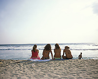 A row of young women sitting by the edge of the sea. Puerto Escondido during spring break (semana santa) vacation 2006