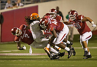 Hawgs Illustrated/BEN GOFF <br /> Briston Guidry (7) and Jonathan Marshall (42), Arkansas defensive ends, tackle Tevin Spells, Florida A&M fullback, in the 4th quarter Thursday, Aug. 31, 2017, during the game at War Memorial Stadium in Little Rock.