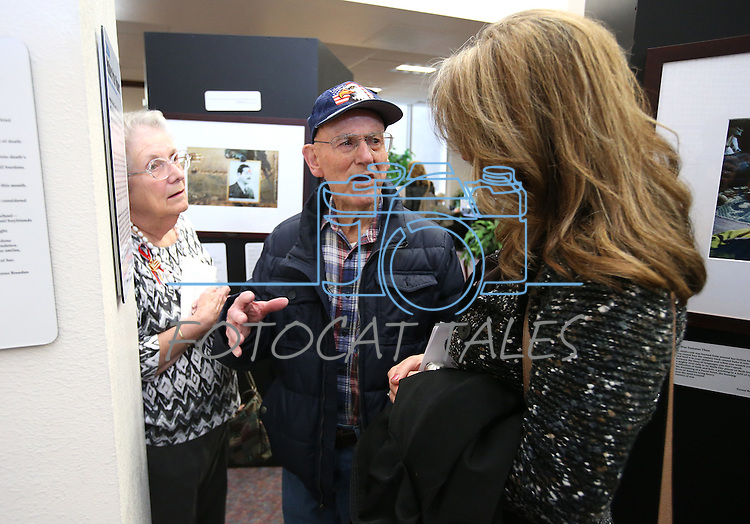 Amy Roby, project manager of the Always Lost: A Meditation on War exhibit talks with Harold and Sherry Siegfried at the Legislative Building in Carson City, Nev., on Monday, April 6, 2015. <br /> Photo by Cathleen Allison/Nevada Photo Source
