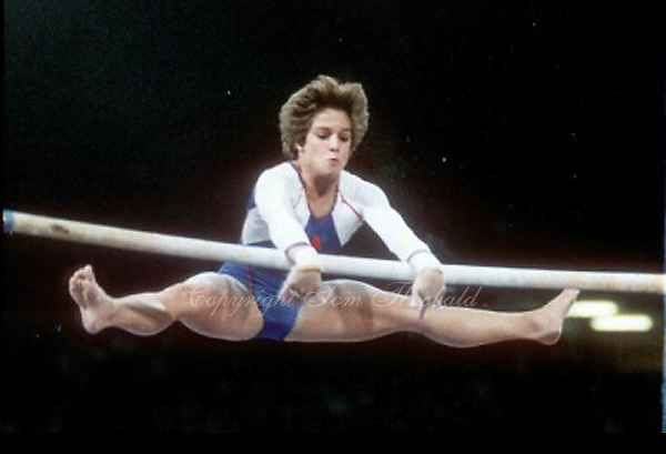 May 15, 1983; Los Angeles, California, USA; Artistic gymnast Mary Lou Retton of USA performs release move on uneven bars at USA vs USSR dual meet at Los Angeles.  Copyright 1983 Tom Theobald.