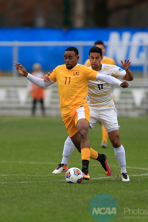 KANSAS CITY, MO - DECEMBER 03:  Mateo Correa (17) of Wingate University and Jermaine Windster (11) of the University of Charleston battle for the ball during the Division II Men's Soccer Championship held at Children's Mercy Victory Field at Swope Soccer Village on December 03, 2016 in Kansas City, Missouri. Wingate beat Charleston 2-0 to win the National Championship. (Photo by Jack Dempsey/NCAA Photos via Getty Images)