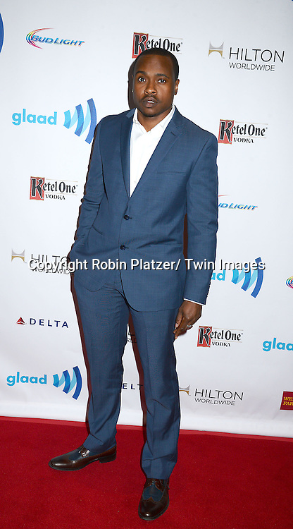 Tiq Milon attends the 25th Annual GLAAD Media Awards at the Waldorf Astoria Hotel in New York City, NY on May 3, 2014.