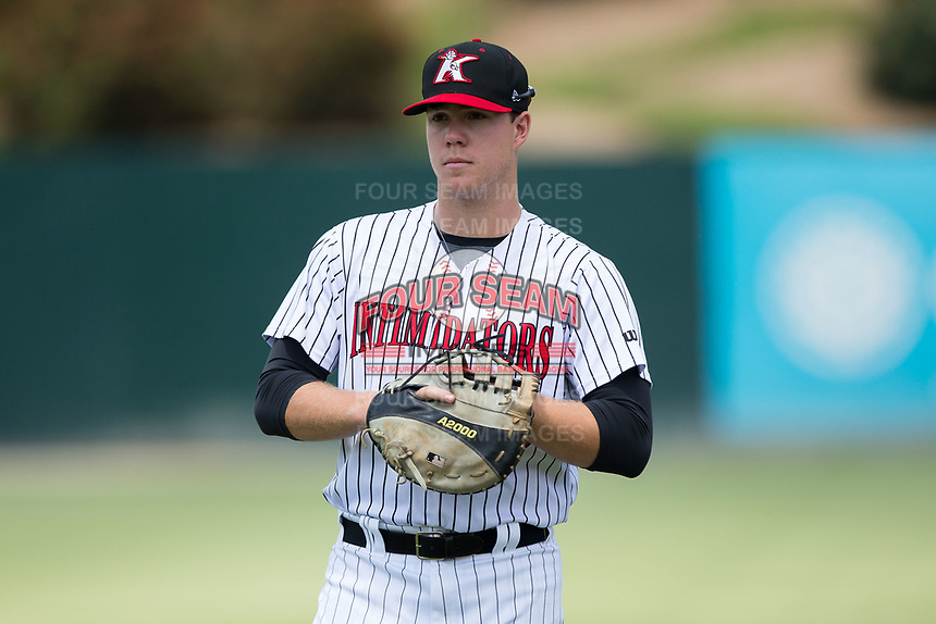 Kannapolis Intimidators first baseman Gavin Sheets (23) warms up in the outfield prior to the game against the Hagerstown Suns at Kannapolis Intimidators Stadium on July 9, 2017 in Kannapolis, North Carolina.  The Intimidators defeated the Suns 3-2 in game one of a double-header.  (Brian Westerholt/Four Seam Images)