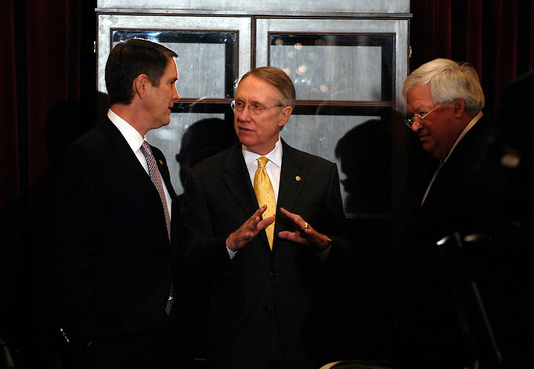 From left, Senate Majority Leader Bill Frist, R-Tenn., Senate Minority Leader Harry Reid, D-Nev., and Speaker Dennis Hastert, R-Ill., confer in the Speaker's hallway while waiting for the arrival of British Prime Minister Tony Blair.