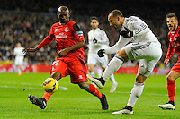 Real Madrid´s Jese Rodriguez and Sevilla's Stephane Mbia during 2014-15 La Liga match between Real Madrid and Sevilla at Santiago Bernabeu stadium in Alcorcon, Madrid, Spain. February 04, 2015. (ALTERPHOTOS/Luis Fernandez) /NORTEphoto.com