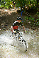 NWA Democrat-Gazette/BEN GOFF @NWABENGOFF<br /> Nick Hancock, a category 3 racer from Russellville, fords a creek Sunday, July 16, 2017, during cross country races on the final day of the 19th annual Fat Tire Festival at Lake Leatherwood City Park in Eureka Springs.