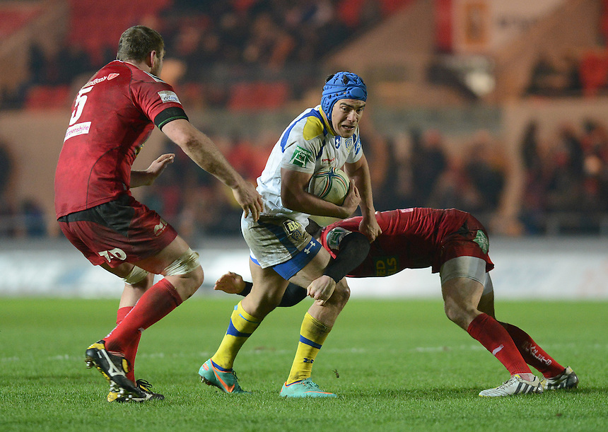 Clermont Auvergne's Benson Stanley is tackled by Scarlets' Kristian Phillips . - CREDIT - CameraSport - Ian Cook - ..Rugby Union - Heineken Cup Pool 5 - Scarlets v Clermont Auvergne - Saturday 19th January 2013 - Parc y Scarlets - Llanelli..© CameraSport - 43 Linden Ave. Countesthorpe. Leicester. England. LE8 5PG - Tel: +44 (0) 116 277 4147 - admin@camerasport.com - www.camerasport.com..