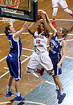SIOUX FALLS MARCH 22:  Mariah Harris #13 from Florida Southern has her shot blocked from behind by Tess Bruffey #54 from Lubbock Christian during their quarterfinal game at the NCAA Women's Division II Elite 8 Tournament at the Sanford Pentagon in Sioux Falls, S.D. (Photo by Dave Eggen/Inertia)