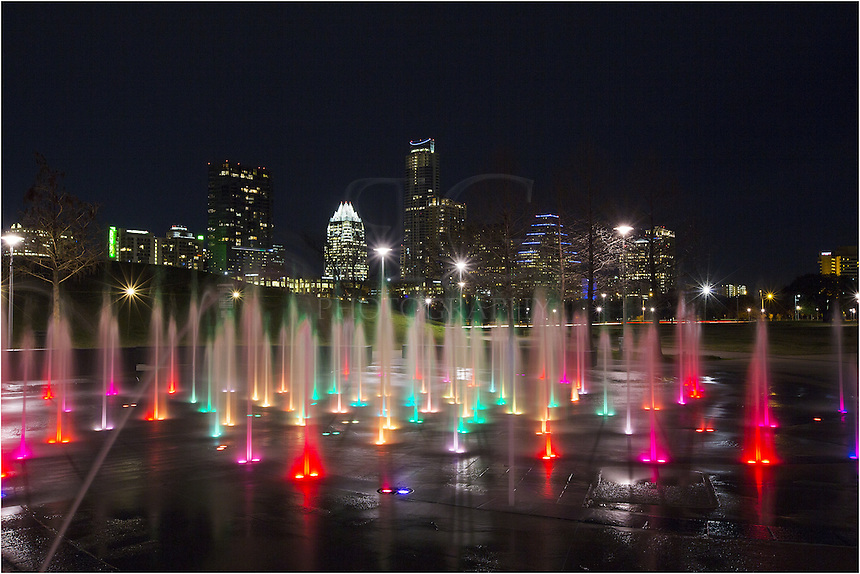 The Austin Skyline is a nice sight at night. The highrises are lit up and rest at the shores of Ladybird Lake. Across the lake from downtown Austin is a little fountain park that lights up with all colors. The streams of water delight kids on hot summer days and amaze onlookers at night...This play area is called the Liz Carpenter Fountain. From a certain angle, you can view the wonderful colors with a great view of the Austin Skyline across the lake. It is hard to beat this Austin cityscape for color and fun.