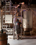 August 7, 2013. Hillsborough, North Carolina.<br />  Brewer Chris Shields, top, checks the mix as owner Erik Myers stands by.<br />  Mystery Brewing Co. is just one of several new breweries to open up in Orange County over the last year. With a taproom just up the road, Mystery has become increasingly popular as the craft beer market in North Carolina grows.