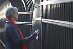 The Rev. Mary Kohlstaedt Huycke prays at the fence surrounding the Federal Detention Center in Seatac, Washington, during a June 24 prayer vigil in support of immigrant parents inside the prison who've been separated from their children. Huycke is district superintendent of the Seven Rivers District of the United Methodist Church.