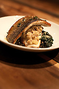 December 3, 2010. Raleigh, NC.. Local pan roasted trout with  apple mostrada, swiss chard and french green lentils at Frazier's Wine Bar.