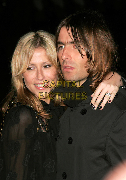 """NICOLE APPLETON & LIAM GALLAGHER.The UK Film Premiere of director Martin Scorsese's """"Shine A Light"""" documentary featuring The Rolling Stones, held at Odeon cinema, Leicester Square, London, England..April 2nd, 2008.headshot portrait arm over shoulder nail varnish polish black married husband silver ring wife .CAP/AH.©Adam Houghton/Capital Pictures."""