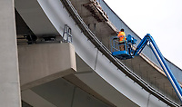 An unidentified worker doing maintenance on Blue Water Bridge.<br /> <br /> I like the flo