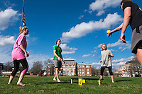 Students playing spike ball on the Drill Field on a sunny Spring afternoon.  Peyton Dungan (in green - civil engineering major), Alaina O'Bryant (in pink - elementary education major), Taylor Davis (in grey - microbiology major), and Davis Pidgeon (in black - industrial engineering major).<br />  (photo by Megan Bean / &copy; Mississippi State University)