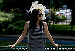 ELMONT, NY - JUNE 09: A woman wears a fancy hat during Belmont Stakes Day at Belmont Park on June 9, 2018 in Elmont, New York. (Photo by Scott Serio/Eclipse Sportswire/Getty Images)