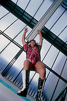 Tania la Guerillera shows her students how to jump from the third rope at the gimnasio Latinoamericano in Mexico City.  June, 2004