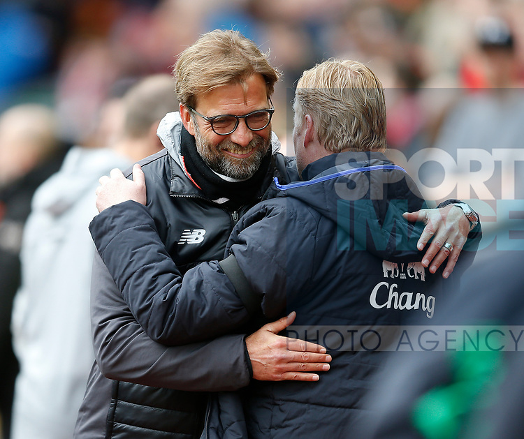 Jurgen Klopp manager of Liverpool hugs Ronald Koeman manager of Everton during the English Premier League match at Anfield Stadium, Liverpool. Picture date: April 1st 2017. Pic credit should read: Simon Bellis/Sportimage