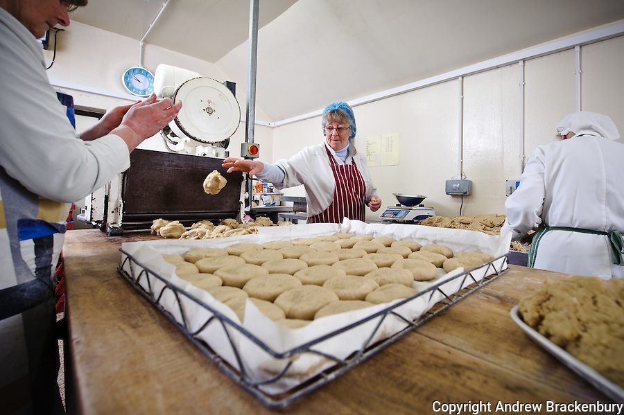 Lady making traditional Melton Mowbray pork pies at F Bailey and Sons butchers, Upper Broughton, Near Melton Mowbray, Leicestershire