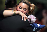 Chantel Blunk hugs a friend following the memorial service for her husband, Colorado shooting victim Jonathan Blunk, in Reno, Nev. on Friday morning, Aug. 3, 2012. (AP Photo/Cathleen Allison)